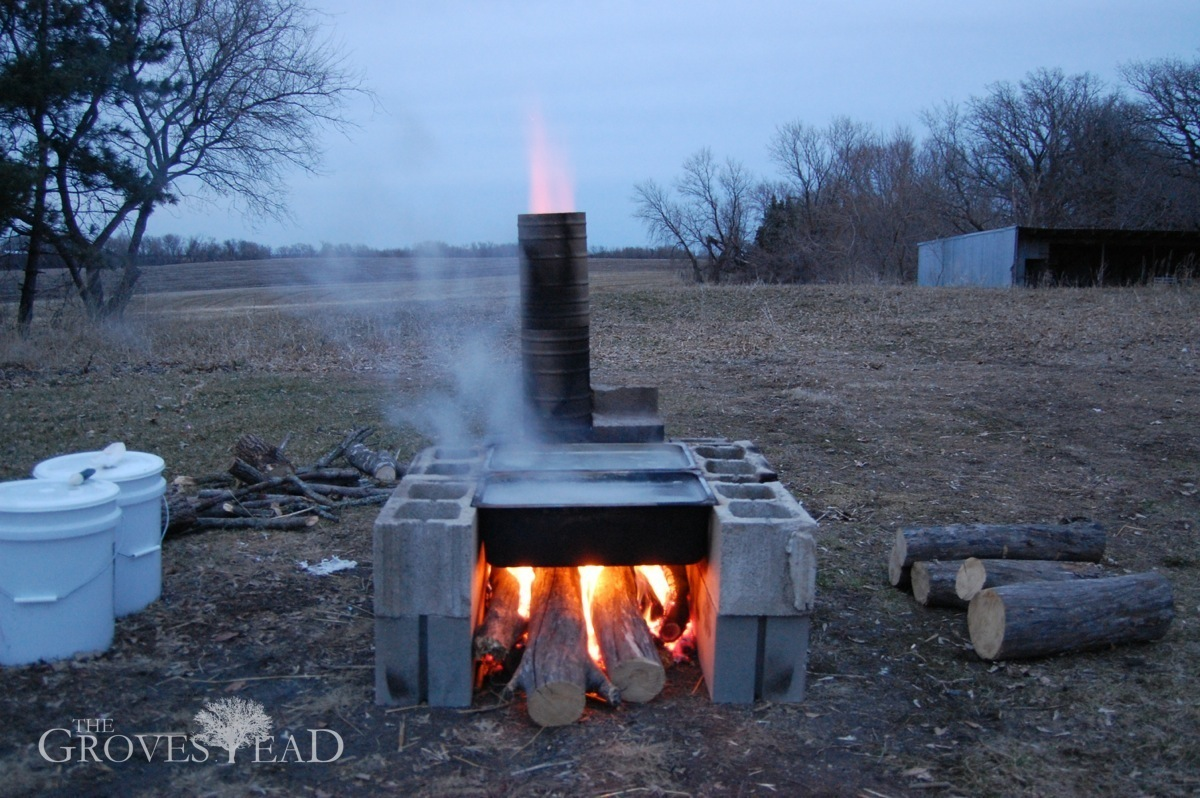Boiling maple sap over home-built evaporator - How To Build An Evaporator (from Stuff Laying Around) The Grovestead