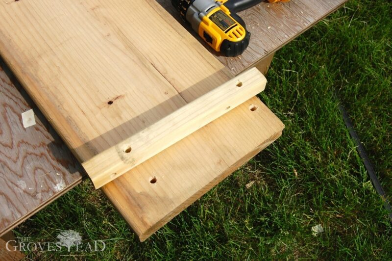Holes drilled through stakes and boards