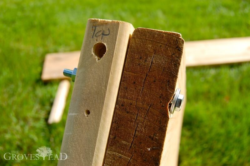 Stake and board of raised bed bolted together