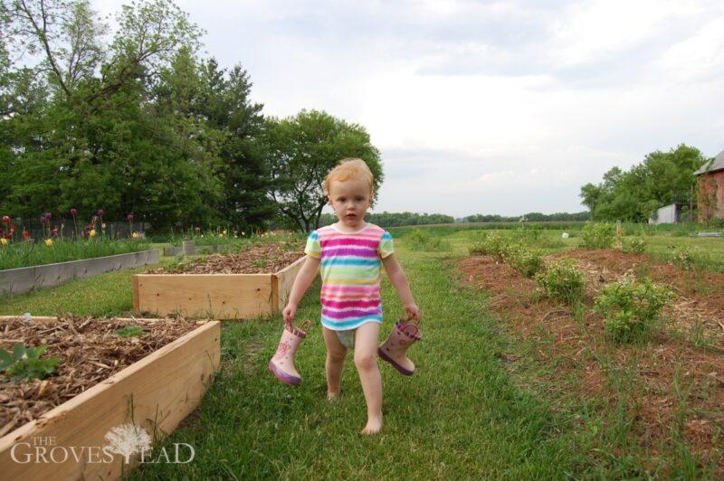 Elsie helping in the garden