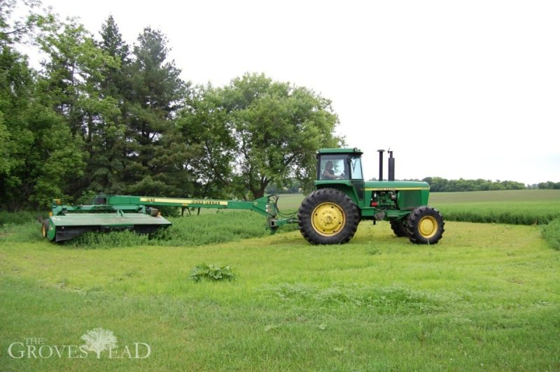 John Deere tractor cutting our hay field