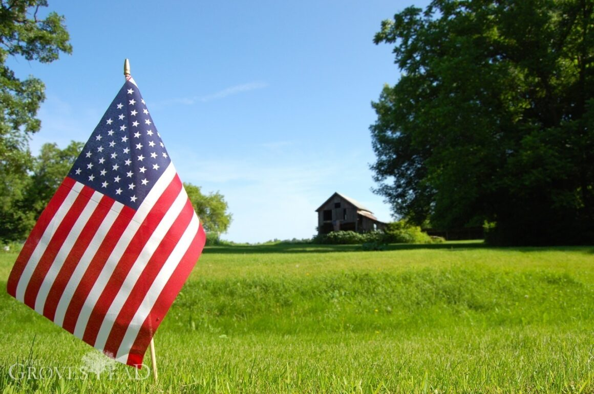 Independence day flag waving in front of farm