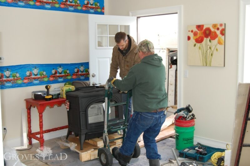 Carrying wood stove through front entryway