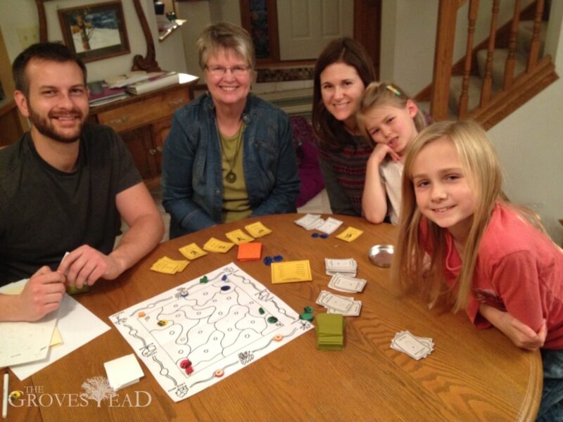 Grandma, sister, and nieces help test out the game board ideas