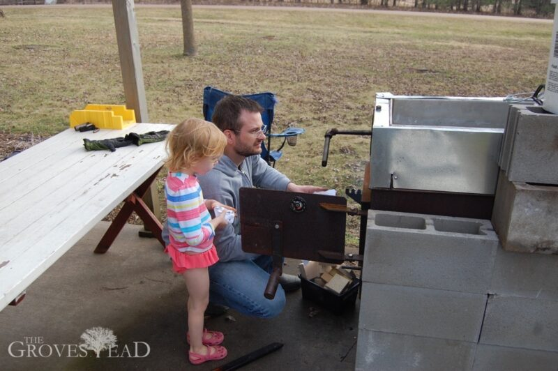 Elsie helping daddy get the evaporator started